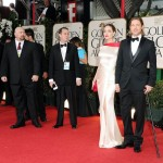 Анджелина Джоли в красно-белом платье Atelier Versace и Брэд Питт в смокинге Ferragamo