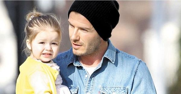 Харпер Бекхэм и ее звездный отец. Фото АР